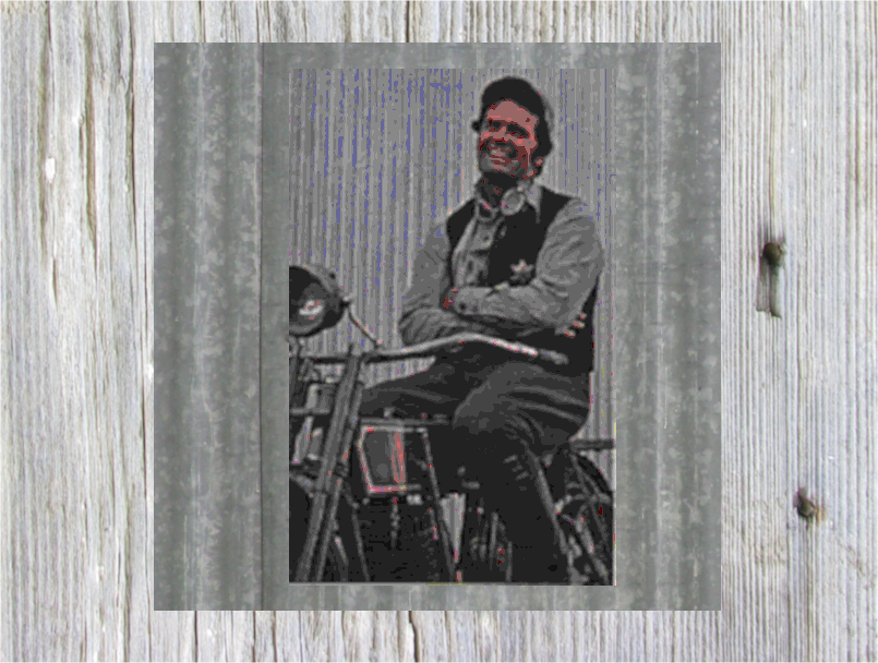 James garner as Nichols sitting on an early Harly Davidson motorbike.